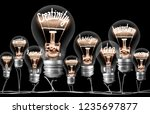 photo of light bulbs on wires... | Shutterstock . vector #1235697877