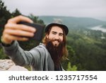 funny blogger makes selfie on a ... | Shutterstock . vector #1235717554