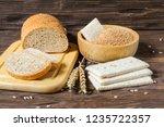 wheat bran  bran bread and dry... | Shutterstock . vector #1235722357