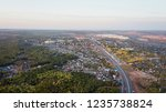 countryland road suburb town... | Shutterstock . vector #1235738824