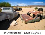 wrecked cars lie abandoned in... | Shutterstock . vector #1235761417