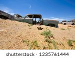 wrecked cars lie abandoned in... | Shutterstock . vector #1235761444