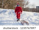 boy with sledge climbing at the ... | Shutterstock . vector #1235767897