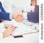 business people shaking hands ... | Shutterstock . vector #1235856901