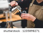 the barista brews a fragrant... | Shutterstock . vector #1235898271