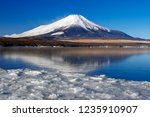 mt fuji  in the early morning.... | Shutterstock . vector #1235910907