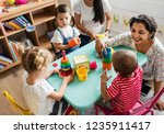nursery children playing with... | Shutterstock . vector #1235911417