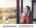 woman are listening to music...   Shutterstock . vector #1235945374