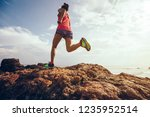 young fitness woman trail...   Shutterstock . vector #1235952514