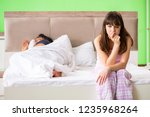 woman and man in the bedroom... | Shutterstock . vector #1235968264