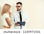 male doctor and female patient...   Shutterstock . vector #1235971531