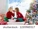 child decorating christmas tree ... | Shutterstock . vector #1235985517