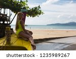 blonde model by the boat on the ... | Shutterstock . vector #1235989267