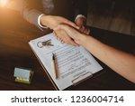 businessmans handshake.... | Shutterstock . vector #1236004714