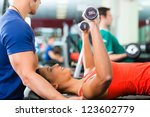 woman with her personal fitness ... | Shutterstock . vector #123602779