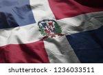 dominican republic flag rumpled ... | Shutterstock . vector #1236033511