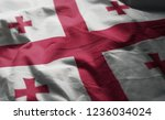 georgia flag rumpled close up  | Shutterstock . vector #1236034024