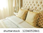 pillows on bed and lamp in... | Shutterstock . vector #1236052861