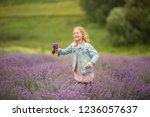 beautiful girl in a lavender... | Shutterstock . vector #1236057637