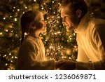 father and daughter sit near... | Shutterstock . vector #1236069871