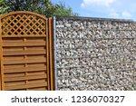 gabion fence wall | Shutterstock . vector #1236070327