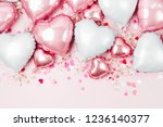 Stock photo air balloons of heart shaped foil on pastel pink background love concept holiday celebration 1236140377