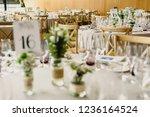 centerpieces in a wedding hall  ...   Shutterstock . vector #1236164524