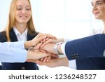 business team showing unity... | Shutterstock . vector #1236248527