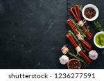 sausages kabanosi. on a black... | Shutterstock . vector #1236277591