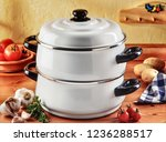white cookingware set with vegetables ready to cook in a kitchen