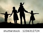 silhouette of a happy family...   Shutterstock . vector #1236312724