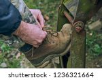 man's hands tying the laces on... | Shutterstock . vector #1236321664