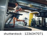 young male on a treadmill at...   Shutterstock . vector #1236347071