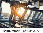 sportsman running on a... | Shutterstock . vector #1236347077
