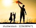 happy parent with children... | Shutterstock . vector #1236389671