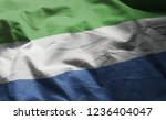sierra leone flag rumpled close ... | Shutterstock . vector #1236404047