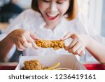attractive asian woman eating... | Shutterstock . vector #1236419161