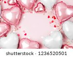 Stock photo air balloons of heart shaped foil on pastel pink background love concept holiday celebration 1236520501