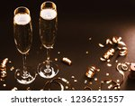 two glasses of champagne with... | Shutterstock . vector #1236521557