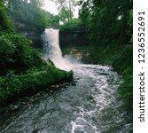 stormy waterfall minnehaha... | Shutterstock . vector #1236552691