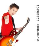 White young boy with a electric guitar shows the thumb gesture - isolated on white background - stock photo
