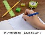 boy doing his homework into... | Shutterstock . vector #1236581047