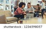 women entrepreneurs sitting in... | Shutterstock . vector #1236598057