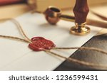Small photo of Notary's public pen and stamp on testament and last will. Notary public tools