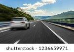 white car rushing along a high... | Shutterstock . vector #1236659971