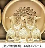 crystal glasses and plates | Shutterstock . vector #1236664741