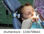 a little girl is treated with... | Shutterstock . vector #1236708661