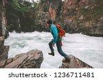 active man jumping on rocks...   Shutterstock . vector #1236711481