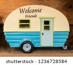 toy camping trailer in blue and ... | Shutterstock . vector #1236728584