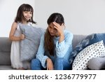 girl sitting on couch with... | Shutterstock . vector #1236779977